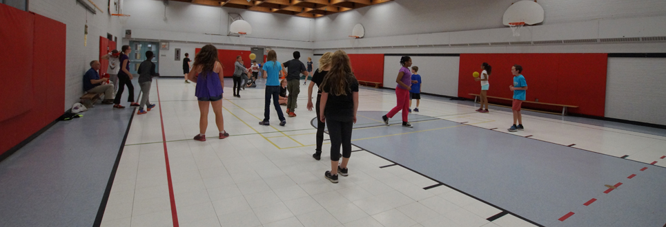 Grade 6 class doing activities in the gym.