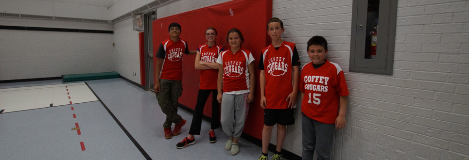 Five students in sport uniforms